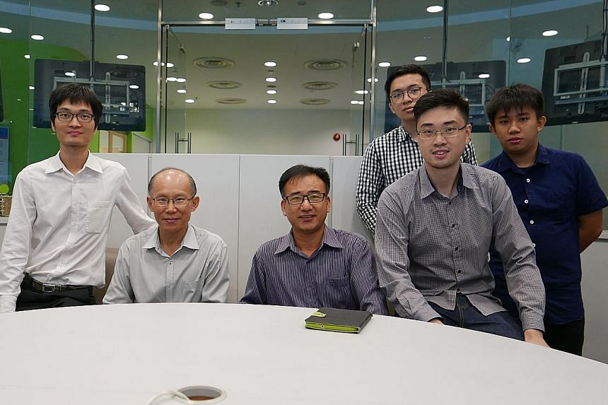 The group working to bring the lightweight, longer-lasting batteries to the market includes (from left) engineer Wang Lei and Dr Han Ming from Temasek Polytechnic's Clean Energy Research Centre, Dr Lu Jinchang and Mr Adec Thng from EnergyNova and stu
