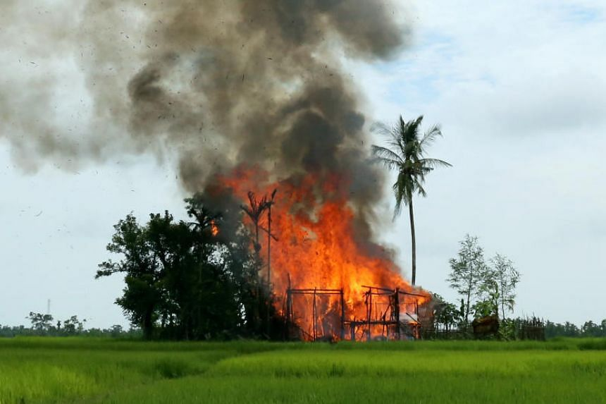 A house is seen on fire in Gawduthar village, Maungdaw township, in the north of Rakhine state, Myanmar on Sept 7, 2017.