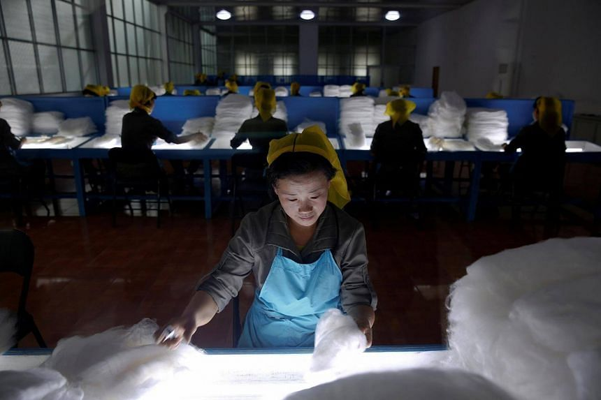 Women work at the Kim Jong Suk Pyongyang textile mill during a government organised visit for foreign reporters in Pyongyang, North Korea, on May 9, 2016.