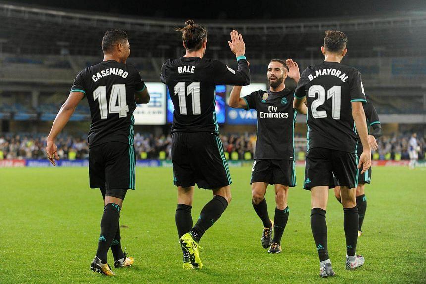 Madrid's Gareth Bale celebrates scoring their third goal against Real Sociedad on Sept 17, 2017.