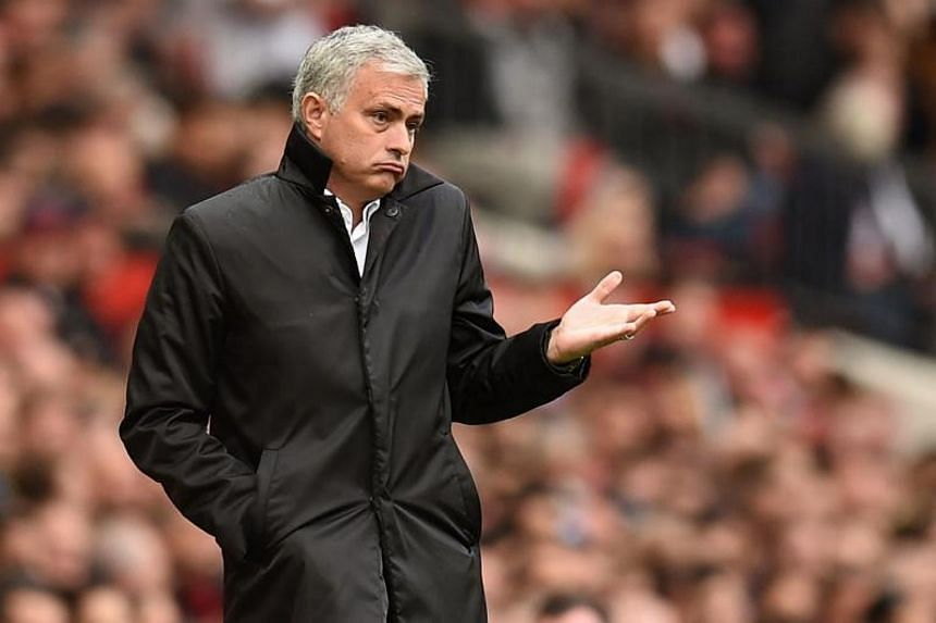 Manchester United's Portuguese manager Jose Mourinho gestures on the touchline during the English Premier League football match between Manchester United and Everton at Old Trafford in Manchester, north west England, on Sept 17, 2017.