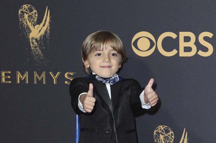 Child actor Jeremy Maguire arrives at the 69th Primetime Emmy Awards.