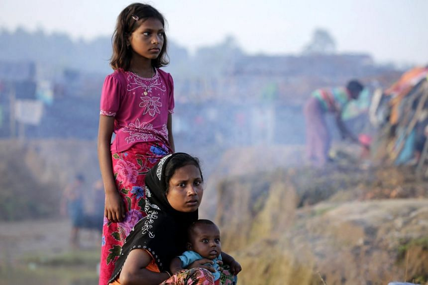 A Rohingya woman with her children near a tent at Tangkhali, Ukhiya, Bangladesh on Sept 17, 2017.