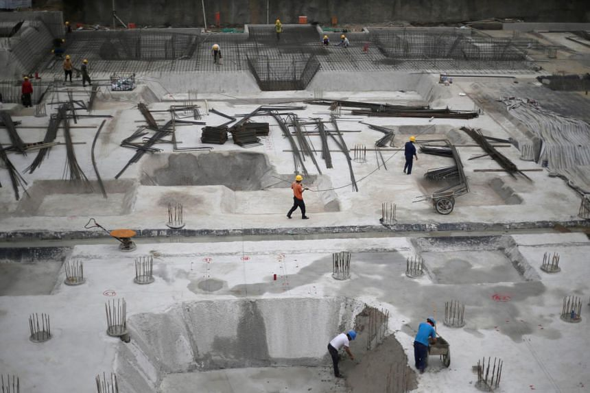 Workers at a construction site in Beijing.