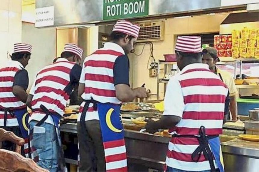A picture of Indian Muslim restaurant workers donning the Malaysian flag as aprons that went viral online.