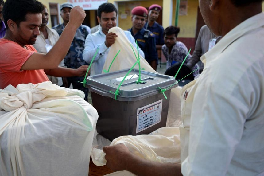Nepalese election worker seals a ballot box after polling stations closed in Nepalgunj, some 510km south-west of Kathmandu, on June 28, 2017.