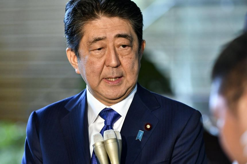 Japanese Prime Minister Shinzo Abe speaks to journalists upon his arrival at the prime minister's official residence in Tokyo, Japan, on Sept 15, 2017.