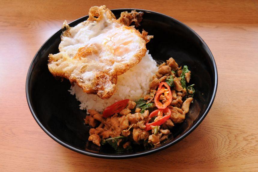 Moom Gapao's stir-fried chicken kao pad gapao.