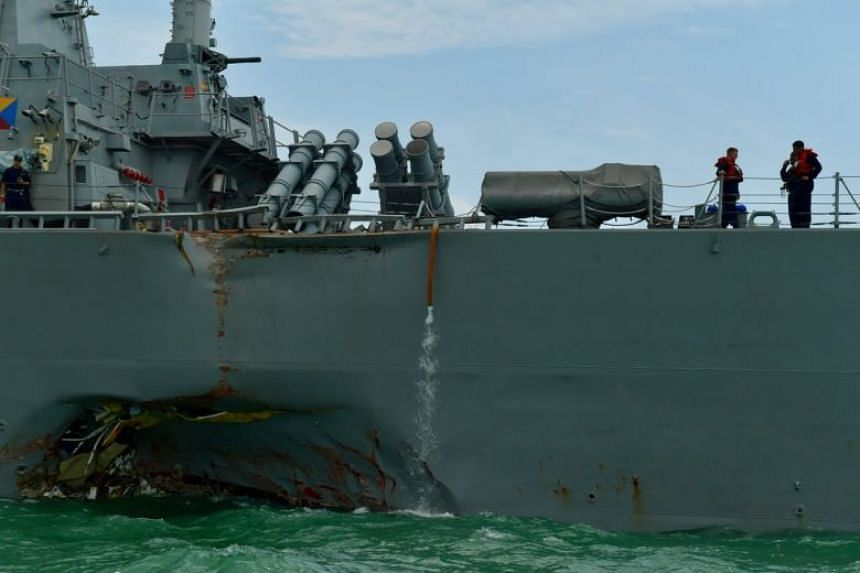 The damage at the port side of USS John S. McCain, a guided-missile destroyer, is estimated to be about eight to 10 metres wide.