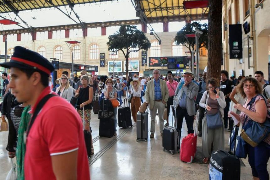 Passengers wait for their trains at The Saint-Charles Station in Marseille on Aug 20, 2017.
