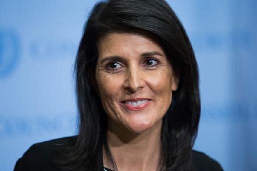 Nikki Haley smiles as she speaks to the media at the United Nations headquarters in New York.