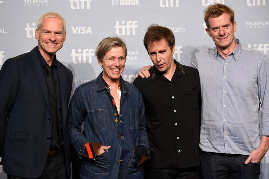 From left to right, writer/director/producer Martin McDonagh, actors Frances McDormand and Sam Rockwell at the 2017 Toronto International Film Festival.