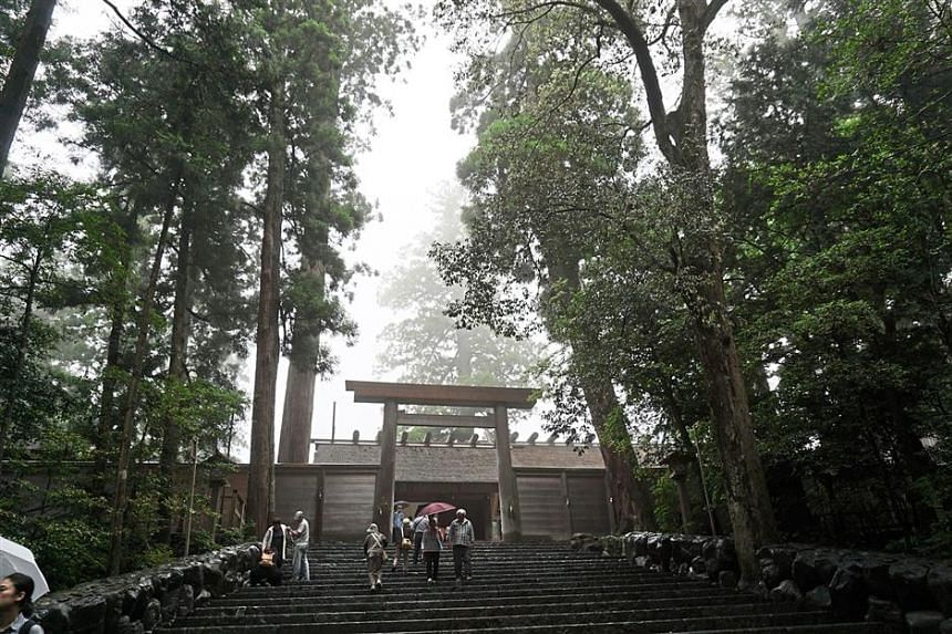 Visitors making their way to the main shrine at the Ise Grand Shrine complex.