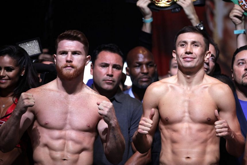 Boxers Canelo Alvarez (right) and Gennady Golovkin face-off during their weigh-in at the MGM Grand Hotel & Casino, on Sept 15, 2017.