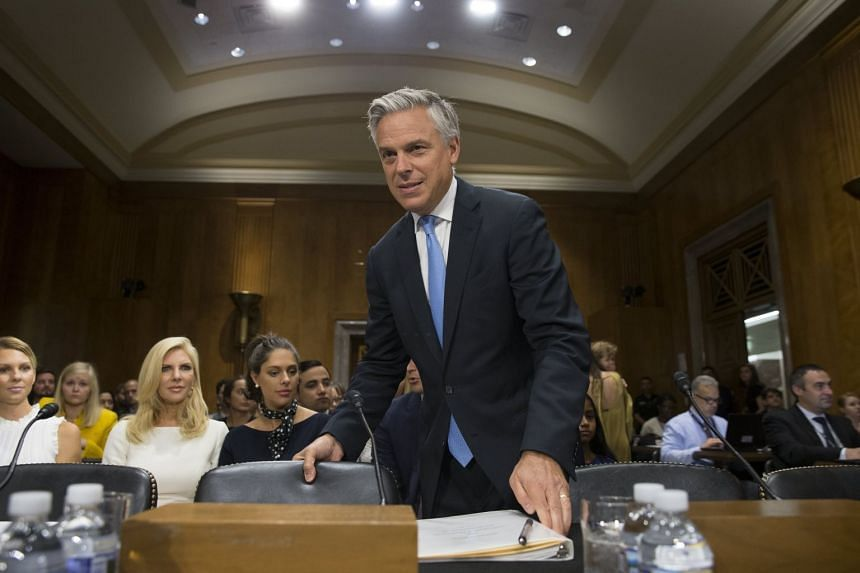 Huntsman takes his seat to testify at the Senate Foreign Relations Committee hearing on his nomination.