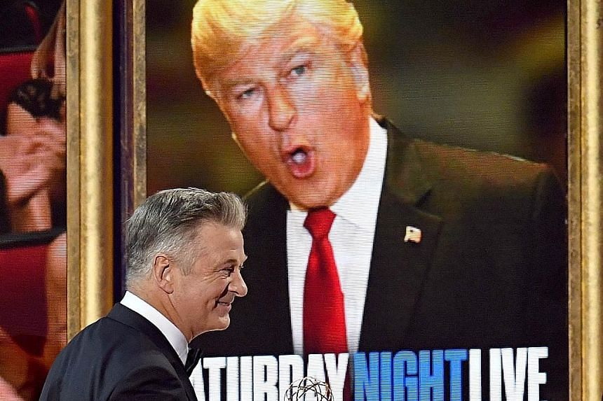 Alec Baldwin (above) won best supporting actor in a comedy series for his portrayal of Mr Trump in Saturday Night Live.