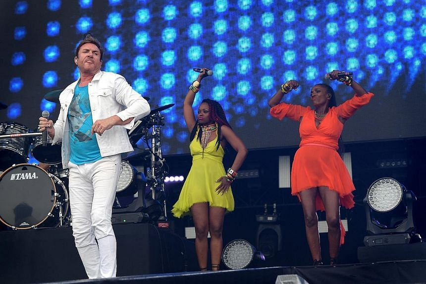 Duran Duran frontman Simon Le Bon (far left) with backup dancers during their set.