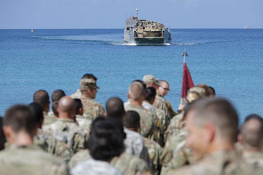 Soldiers from the 602nd Area Support Medical Company waiting on a beach for a Navy landing craft as their unit evacuates in advance of Hurricane Maria, in Charlotte Amalie, St Thomas, in the US Virgin Islands, on Sunday.