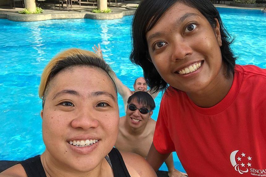 Paralympic swimmer Theresa Goh and para-archer Nur Syahidah Alim chilling out at the pool at the Asean Para Games in Kuala Lumpur.