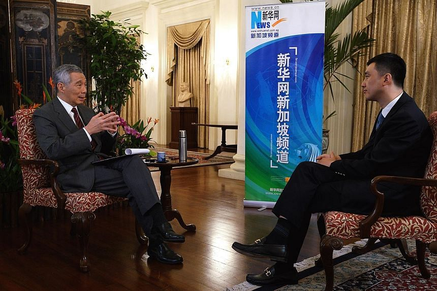 Prime Minister Lee Hsien Loong being interviewed by Mr Wu Lei, deputy general manager of Xinhua News Agency Asia-Pacific headquarters and general manager of Xinhuanet Singapore, at the Istana last Saturday.