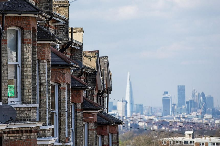 A row of residential properties in front of the City of London financial district. The capital's property market has been the hardest hit due to sluggish economic growth in the wake of the Brexit vote.