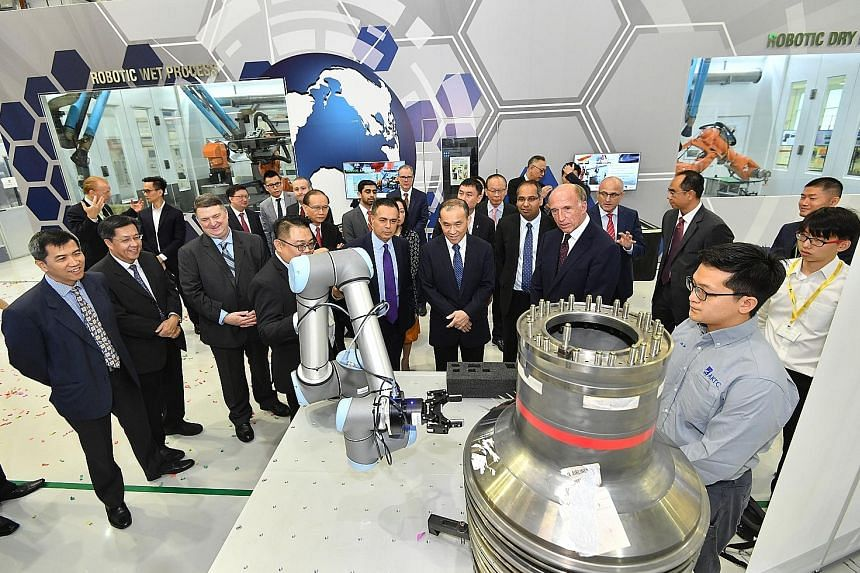 A demonstration of a smart assembly system at A*Star's Advanced Remanufacturing and Technology Centre on Sunday, when Rolls-Royce, A*Star and SAESL signed an agreement to invest up to $60 million to set up the Smart Manufacturing Joint Lab, which wil