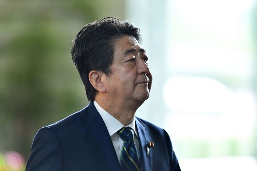 Japan's Prime Minister Shinzo Abe arriving at his official residence in Tokyo.