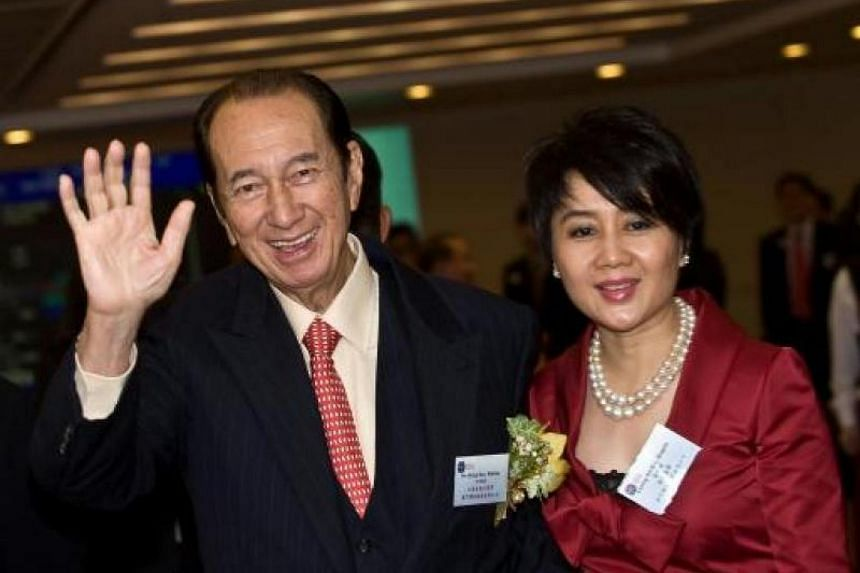 This file photo taken on July 16, 2008 shows Macau casino tycoon Stanley Ho (left) with his fourth wife Angela Leong (right) at the listing ceremony of his part-owned company SJM Holdings Limited in Hong Kong.