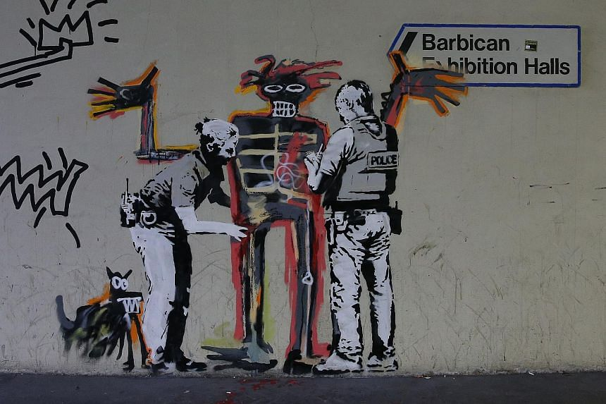 Street artist Banksy paid tribute to Jean-Michel Basquiat with two new murals in London near a major exhibition of the late US artist opening this week.