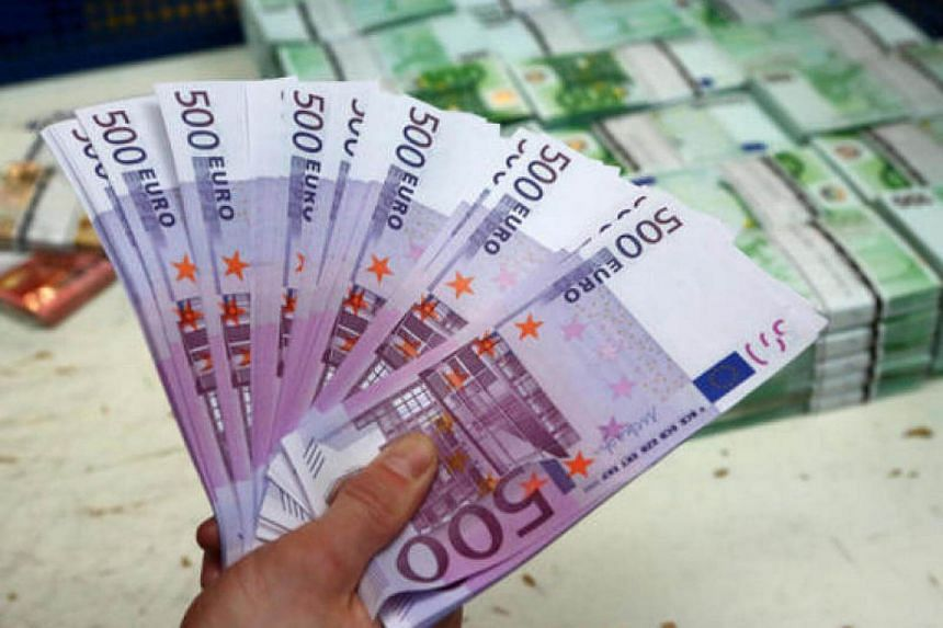 Two people tried to cram about €100,000 (S$161,107) in €500 notes down toilets in three Geneva restaurants and an office of banking giant UBS.