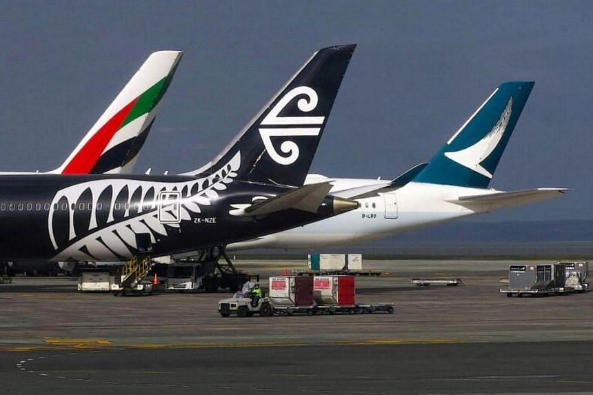 Air New Zealand and Cathay Pacific planes on the tarmac at Auckland Airport on June 25, 2017.