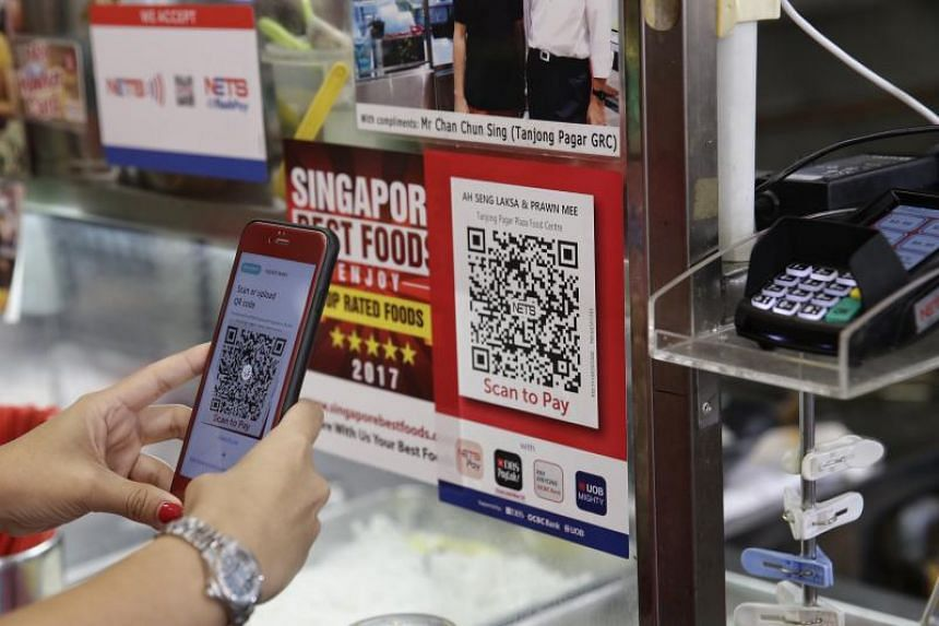 A patron making a purchase by scanning the QR code at Tanjong Pagar Plaza Market and Cooked Food Centre on September 9, 2017.