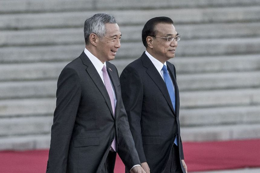 Singapore Prime Minister Lee Hsien Loong and his Chinese counterpart Li Keqiang (right) during a welcome ceremony at the Great Hall of the People in Beijing, China, on Sept 19, 2017. Premier Li has accepted PM Lee's invitation to visit Singapore.