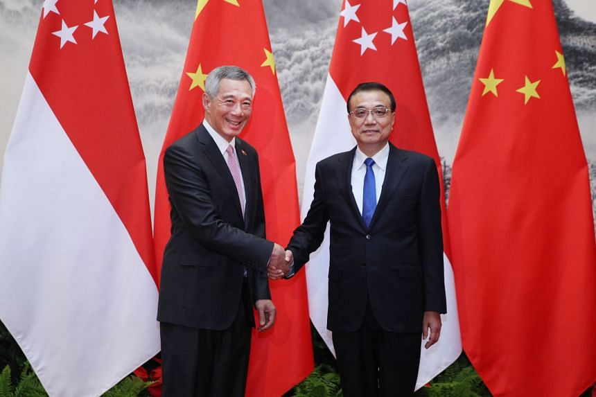 Chinese Premier Li Keqiang welcoming Singapore PM Lee Hsien Loong at the start of the latter's official three-day visit to Beijing, on Sept 19, 2017.