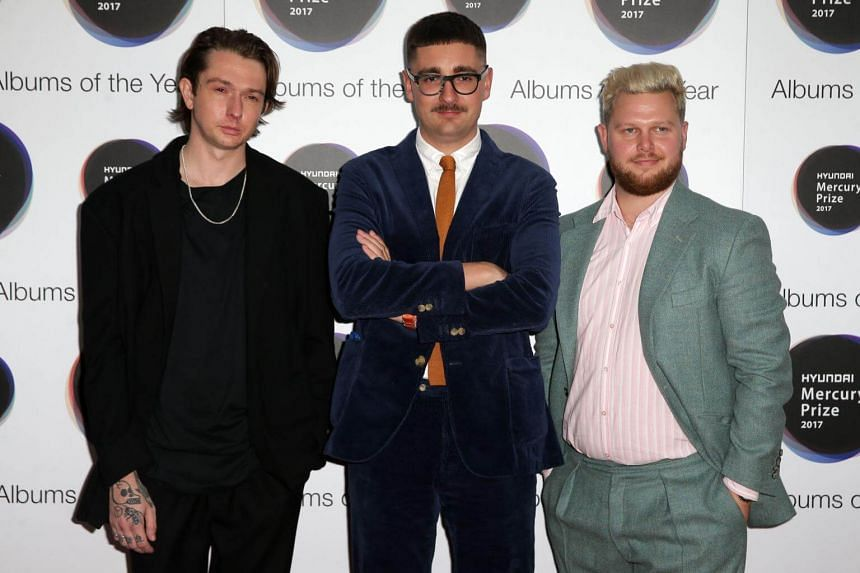 The three members of alt-j, Joe Newman, Thom Sonny Green and Gus Unger-Hamilton pose for a photograph at the 2017 Mercury Music prize awards ceremony in central London on Sept 14, 2017.
