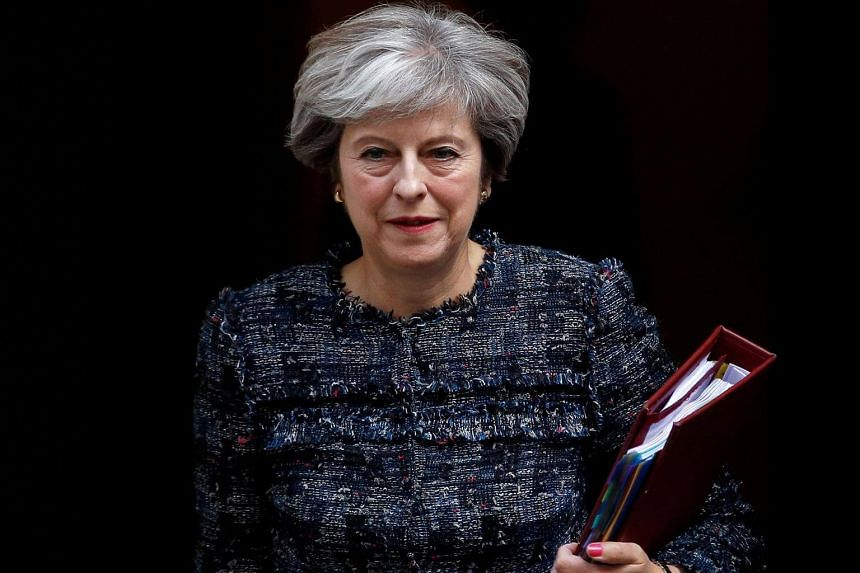 Britain's Prime Minister Theresa May leaves 10 Downing Street to attend Prime Minister's Questions, in London, on Sept 13, 2017.