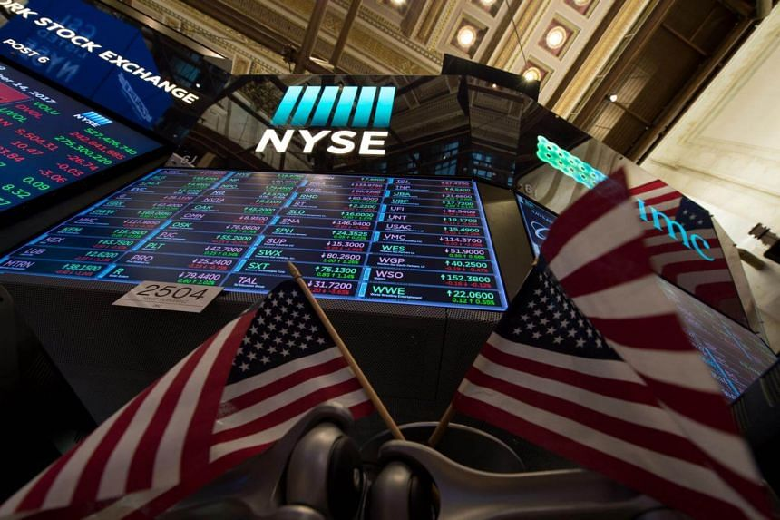 A video board and American flags on the floor at the closing bell of the Dow Industrial Average at the New York Stock Exchange on Sept 14, 2017.