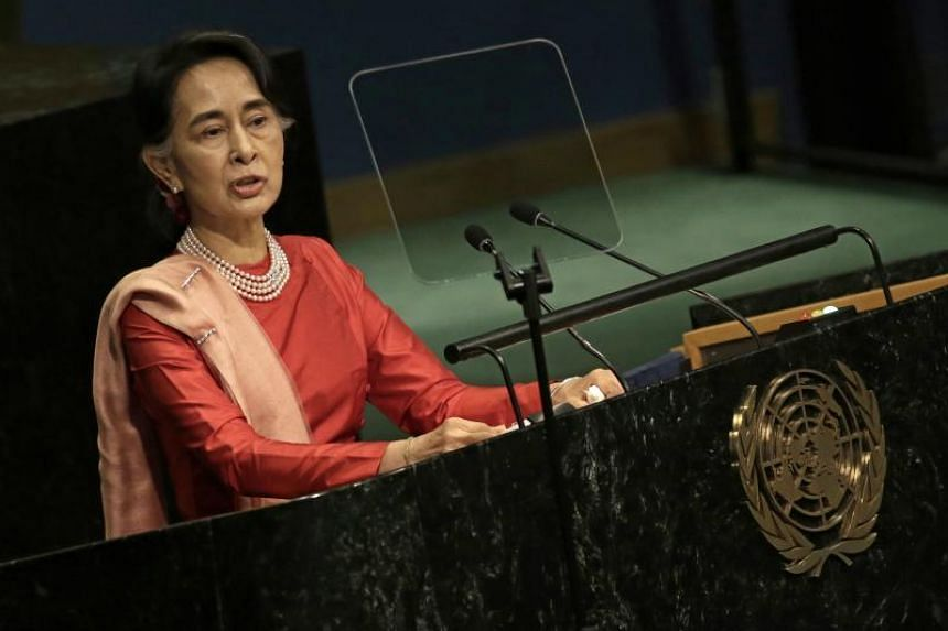 Aung San Suu Kyi has been decried overseas for failing to condemn the generals, with whom she is in a delicate power-sharing arrangement.