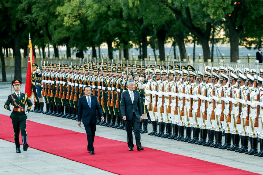 Singapore Prime Minister Lee Hsien Loong and his Chinese counterpart Li Keqiang (left) review honour guards during a welcome ceremony at the Great Hall of the People in Beijing, China, on Sept 19, 2017.