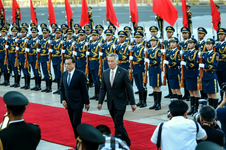PM Lee Hsien Loong, who is on a three-day official visit to China, attends a welcome ceremony with Chinese Premier Li Keqiang (left) at the Great Hall of the People on Sept 19, 2017.