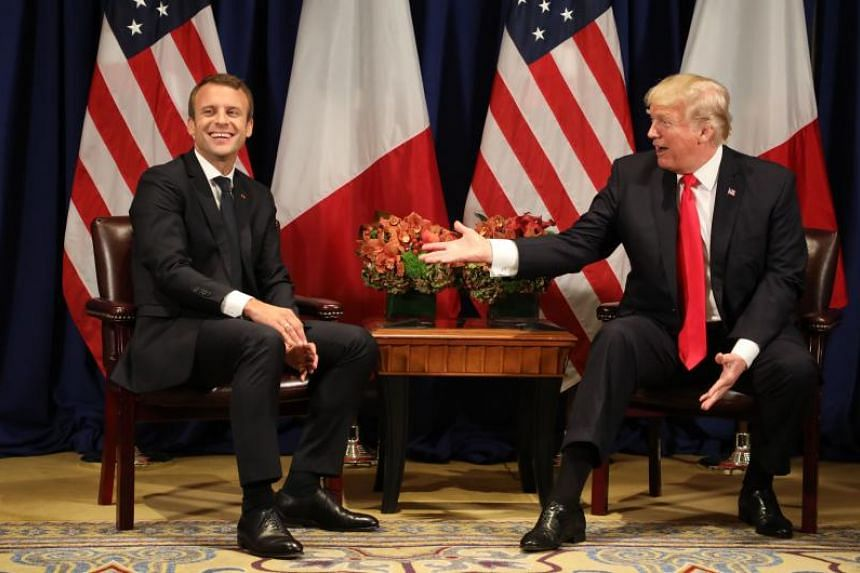 France's president Emmanuel Macron (left) laughs with US President Donald Trump before the 72nd session of the United Nations General Assembly on Sept 18, 2017.