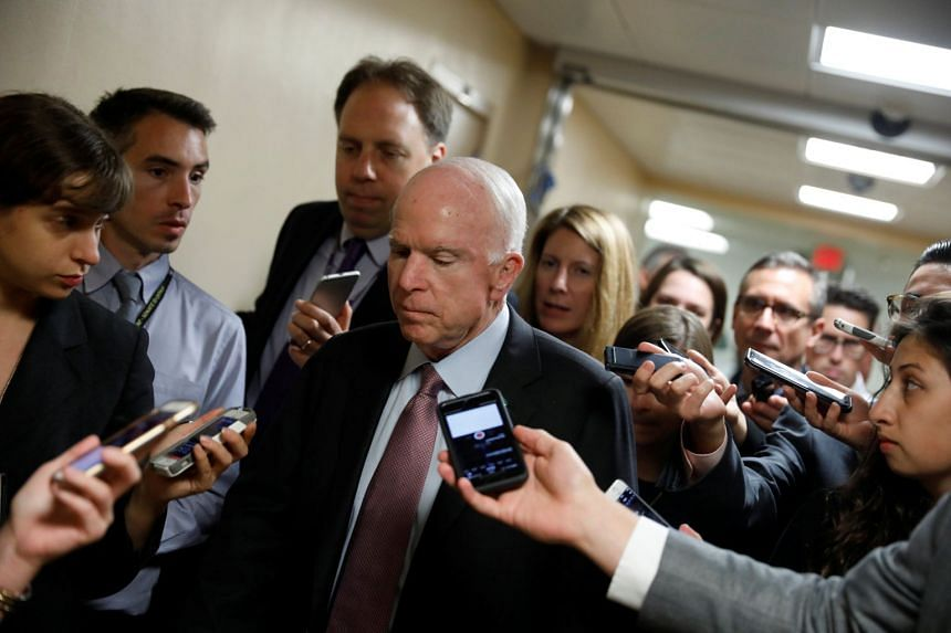 McCain speaks with reporters on Capitol Hill in Washington, Sept 19, 2017.