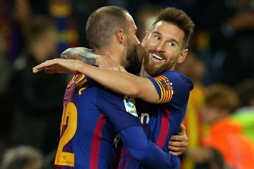 Barcelona's Lionel Messi celebrates scoring their sixth goal with Aleix Vidal.
