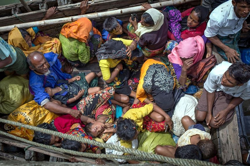 Rohingya refugees arriving by boat at Shah Parir Dwip on the Bangladesh side of the Naf River after fleeing violence in Myanmar on Sept 12, 2017.