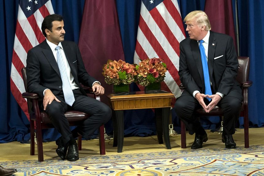 President Donald Trump meets with Sheikh Tamim bin Hamad Al Thani, the Emir of Qatar, at the Palace Hotel in New York.