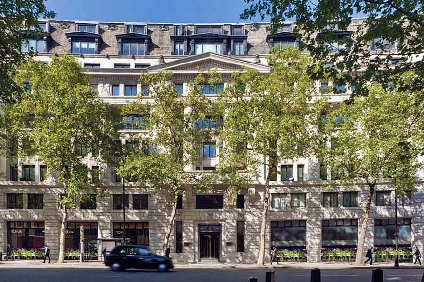 Above: Aldwych House, a 174,000 sq ft building near Covent Garden in London, has been leased to tenants after a recent refurbishment. Left: Ms Angela Leong, who has a net worth of $5 billion, with her husband, Macau tycoon Stanley Ho, in a 2009 photo