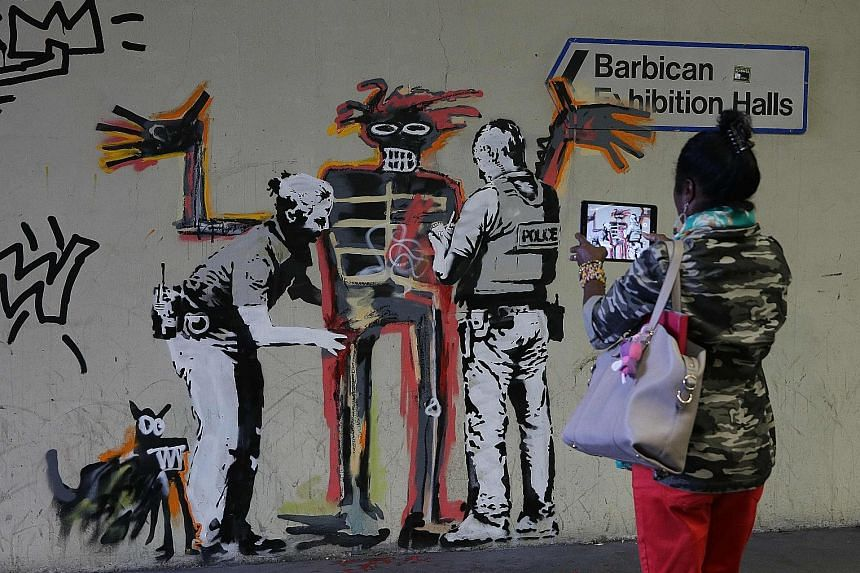 Street artist Banksy paid tribute to the late Jean-Michel Basquiat with two new murals at the Barbican Centre in London.