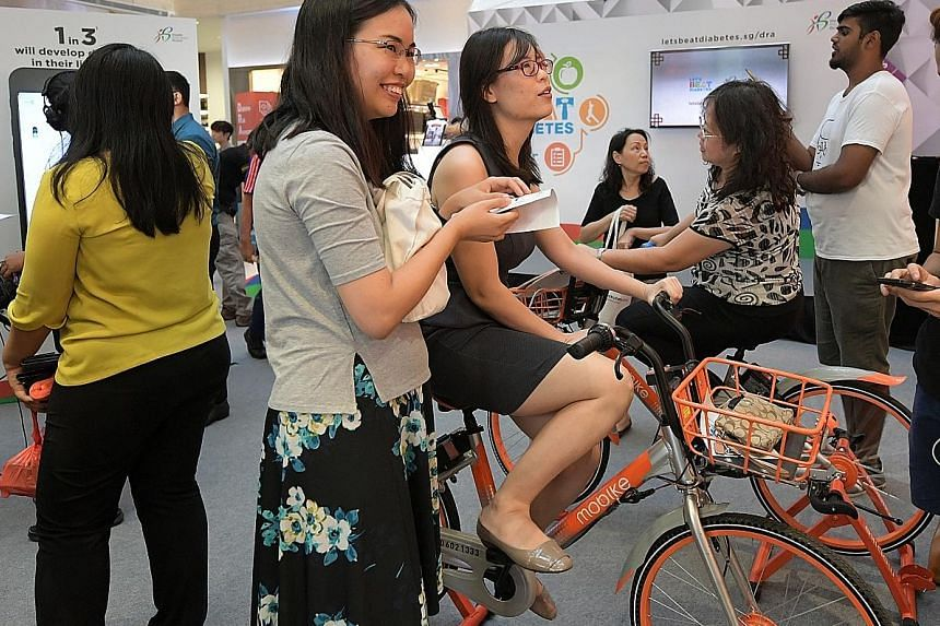 Members of the public who cycled for a minute at the Mobike counter at the roadshow yesterday received a $10 promo code and a free towel.