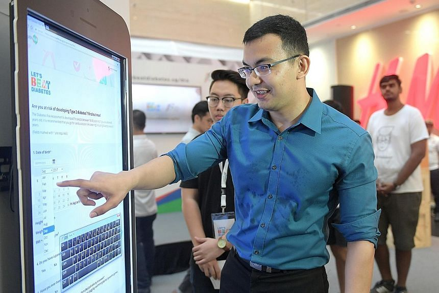 Analyst Herman Benny filling out the Ministry of Health's Diabetes Risk Assessment to determine if he is at risk of the disease at the Diabetes Risk Assessment Roadshow at One Raffles Place yesterday.