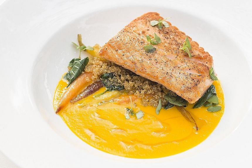 Chef Jean- Georges Vongerichten's new creations include miso-marinated grilled sirloin with coriander pesto and sesame seeds on a bed of wilted spinach; and seared salmon in a carrot-coconut sauce, with baby carrots and basil (above).